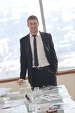 Young business man alone in conference room Royalty Free Stock Images