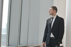 Young business man alone in conference room Royalty Free Stock Photo