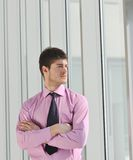Young business man alone in conference room stock image
