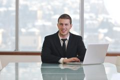 Young business man alone in conference room Stock Photos
