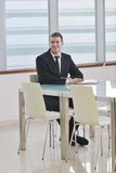 Young business man alone in conference room Stock Photography