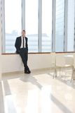 Young business man alone in conference room Stock Images