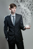 Young business man with alphabet letter Stock Images