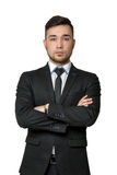 Young business man, arms crossed his chest, isolated on a white background Royalty Free Stock Photography