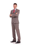 Young business man with arms folded. Full length of young business man standing with arms folded isolated on white background stock photos