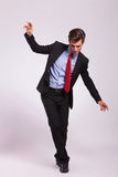 Young business man balancing Stock Images