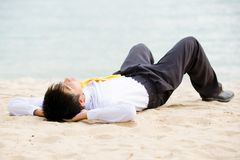 Young business man at the beach Royalty Free Stock Photos