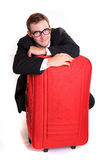 Young business man behind red luggage Royalty Free Stock Photos