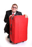 Young business man behind red luggage Royalty Free Stock Images