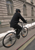 Young business man on a bicycle. Young businessman with helmet riding a bicycle in a city Stock Photo