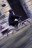 Young business man on a bicycle. Young businessman with helmet riding a bicycle in a city Stock Photos