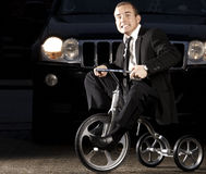 Young business man on bike royalty free stock image