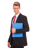 Young business man with a blue notepad Stock Photography