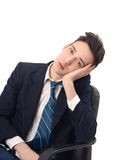 Young business man bored in the chair. Royalty Free Stock Photography