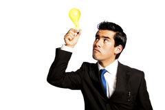 Young business man with bright bulb idea Royalty Free Stock Image