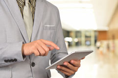 Young Business Man Browsing Web on tablet at the airport. Stock Image
