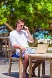Young business man calling by cell phone in Royalty Free Stock Images
