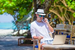 Young business man calling by cell phone on white Royalty Free Stock Photography