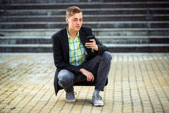 Young business man calling on mobile phone outdoor Royalty Free Stock Photos