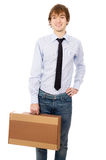 Young business man carries a box Royalty Free Stock Photos