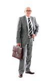 Young business man carrying a suitcase Royalty Free Stock Photos