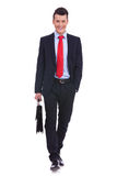 Young business man carrying a suitcase Stock Photo
