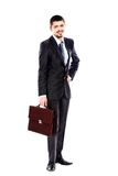Young business man carrying a suitcase on white Stock Photos