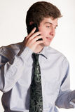 Young business man on cell phone Stock Photos