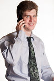 Young business man on cell phone Stock Photography
