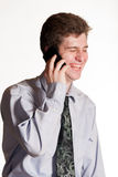 Young business man on cell phone Royalty Free Stock Photos