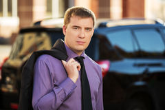 Young business man on the city street Royalty Free Stock Images