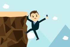 Young business man climb the hill to take selfie. Royalty Free Stock Photo