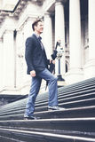 Young business man climbing steps on way to work Stock Photos