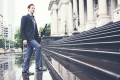 Young business man climbing steps on way to work horizontal Royalty Free Stock Photography
