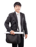 Young business man and computer laptop suit bag and handle paper. Working plan wearing western suit standing and smiling to camera isolated white background Royalty Free Stock Photo