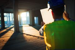 Young business man construction site engineer. With blue print royalty free stock image