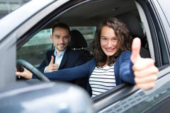 Free Young Business Man Couple In Their Brand New Car Stock Photography - 42052882