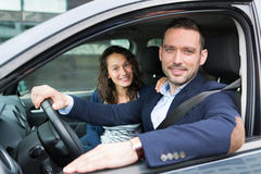 Young business man couple in their brand new car Stock Image
