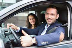 Young business man couple in their brand new car Stock Photography