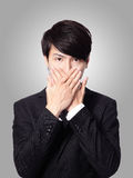 Young business man covering his mouth Royalty Free Stock Photo
