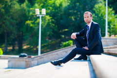 Young business man in dark suit Royalty Free Stock Image