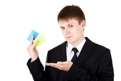 Young business man demonstrate credit cards Royalty Free Stock Photo