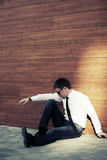 Young business man in depression at the wall Stock Images