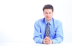 Young business man on a desk Stock Image