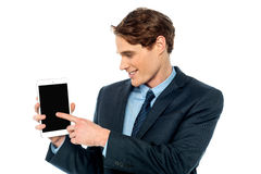 Young business man displaying his new tablet Stock Photo