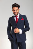 Young business man in double breasted suit smiling Stock Photography