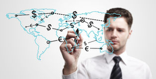 Young business man drawing a global network royalty free stock photography