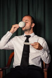 Young business man drinking coffee Stock Image