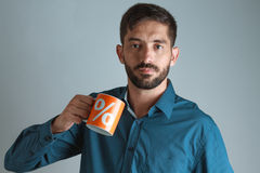 Young business man drinking coffee / tea Royalty Free Stock Image