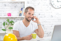 A young business man drinking a cup of coffee Royalty Free Stock Image